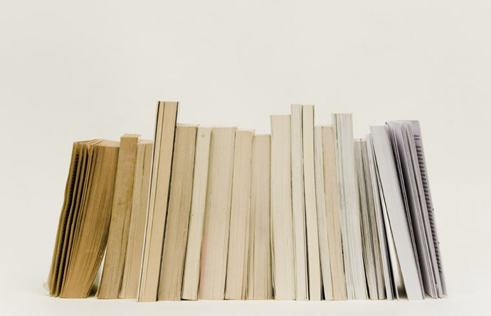 A progressive chart of discolored pages, from cinnamon to glacier white.