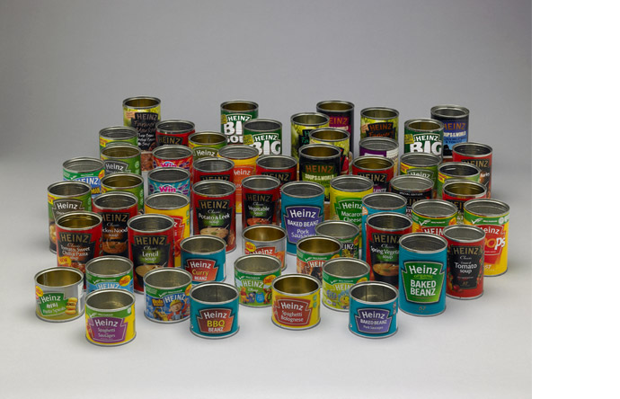 A collection of empty Heinz cans create a psychedelic still life.