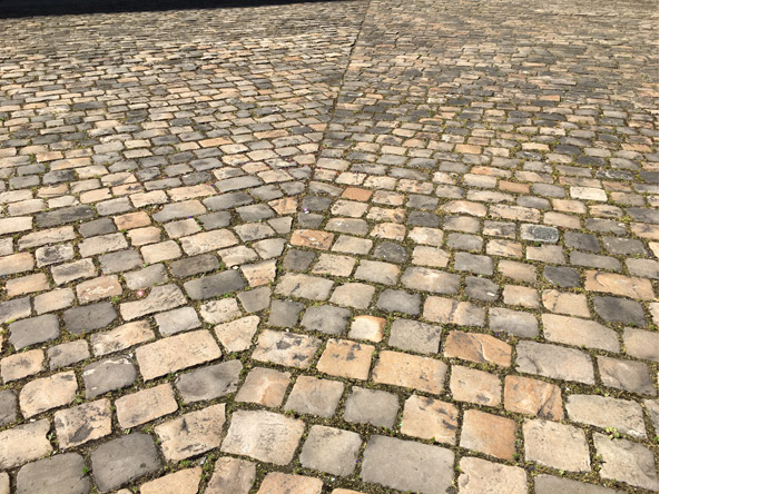 3/5 -- Cobblestones are symbolic artefacts, building blocks of the myth of the barricades.