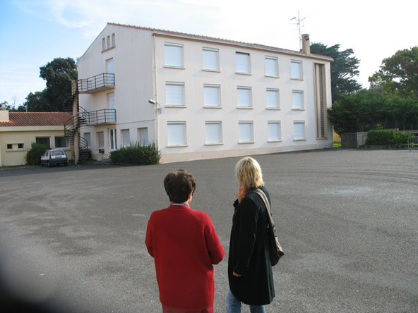2/5 - Soeur Marie takes Lilly on a tour of the school ground. The dorm is now closed