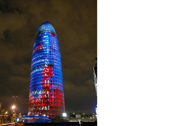 2/6 - Designed by Jean Nouvel, the bullet-shaped building becomes a garish beacon at night