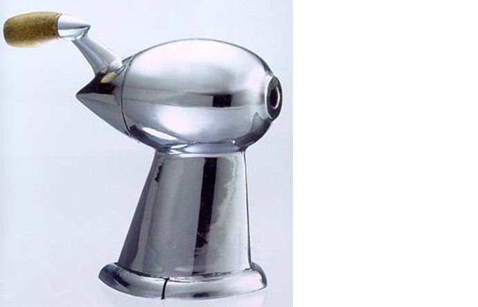 2/9 - A chromed pencil sharpener shaped like a rocket, 1933