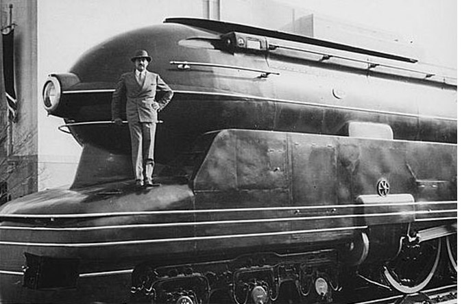 1/9 - Raymond Loewy stands on his locomotive design for the Pennsylvania Railroad, 1938