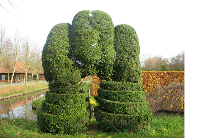 7/10 - Twin topiaries are temporarily parked near a canal,